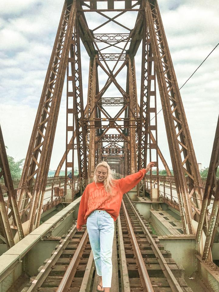 spellbound travels girl on bridge in hanoi