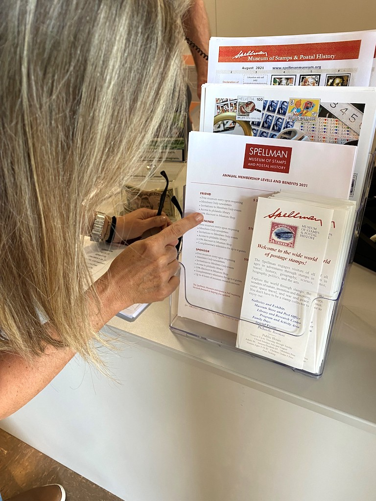 Woman pointing at a brochure