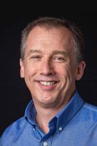 headshot of Mark Spencer