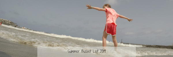child at the beach, summer bucket list