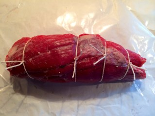 Tied up, it looks like this. Now fold the butcher paper around it, wrapped up and refrigerate, at least a few hours, I prefer overnight......set it out at least an hour prior to cooking.