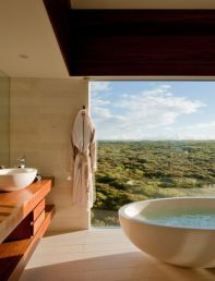 Bath with an outdoor vista
