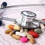 33255689 - cardiogram ekg and spilled tablets.medical concept