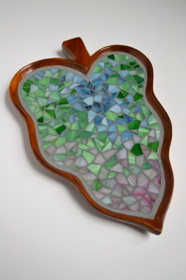 stained glass mosaic on wooden leaf plate