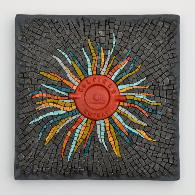 """Incendio"" (2013) -- stone from the banks of the Ottawa River, smalti, and a fire hose cap, 12"" x 12"""