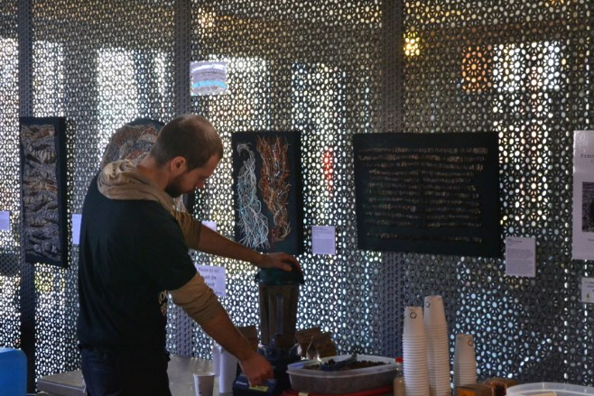My mosaics look on as one of the Chocosol guys whips up some Mexican drinking chocolate.