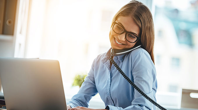 Woman Talking On A Hosted Voip Phone - Speros - Savannah, GA