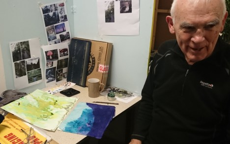 Man with two watercolour paintings