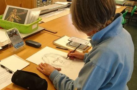 Woman drawing self-portrait
