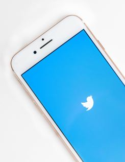 Twitter Logo on blue background of white Iphone