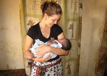 Alexandra Carter with a baby in Kenya