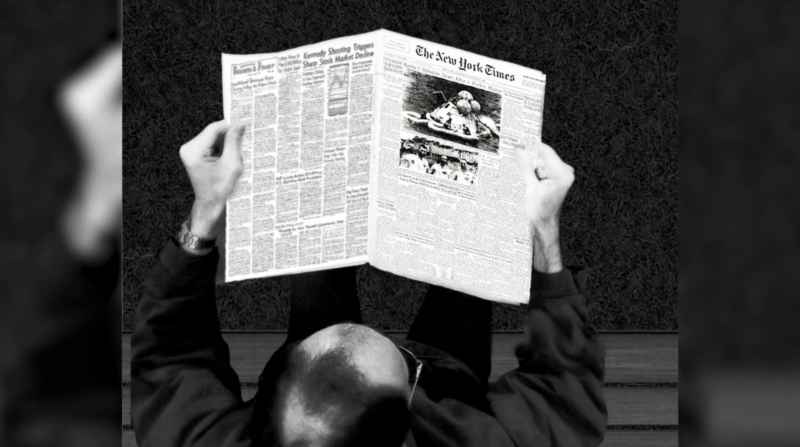14 Man Reading Newspaper