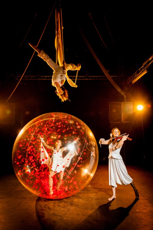 Visual show with aerialist on tissues-Trapeze, dancer in a plastic bubble, violinist.