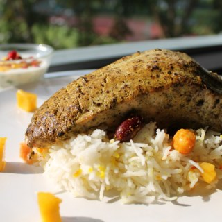 Pepper Crusted Salmon on Peshawari Pilau with Mango and Pomegranate Raita