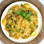 Chicken biryani cooked in Instant Pot served on a white plate