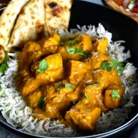 Diced cubes of chicken tossed in tikka masala curry, served over cumin rice