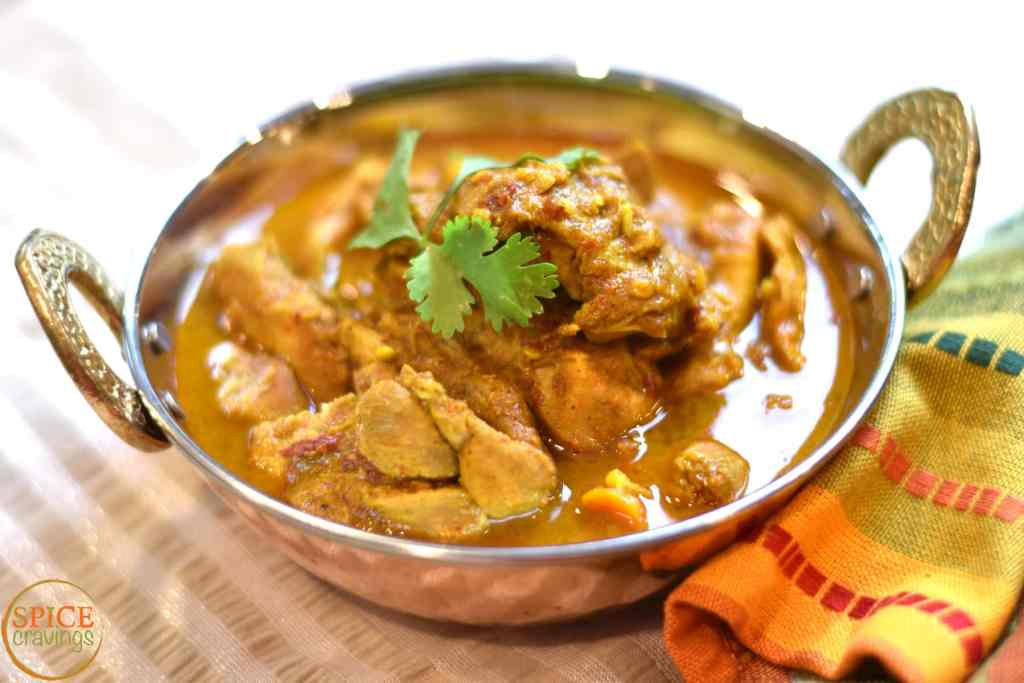 Chicken Vindaloo is an extremely popular Indian chicken curry from the western coast. It's a local adaptation of the Portuguese dish, Carne de vinha d'alhos, which literally means, meat marinated in wine and garlic. How can you go wrong with that!  #food #foodie #foodblogger #delicious #recipe #instantpot #recipes #easyrecipe #cuisine #30minutemeal #instagood #foodphotography #tasty #indian #curry #chicken #glutenfree #lowcarb