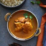 Chili sauce based chicken vindaloo served in a copper bowl