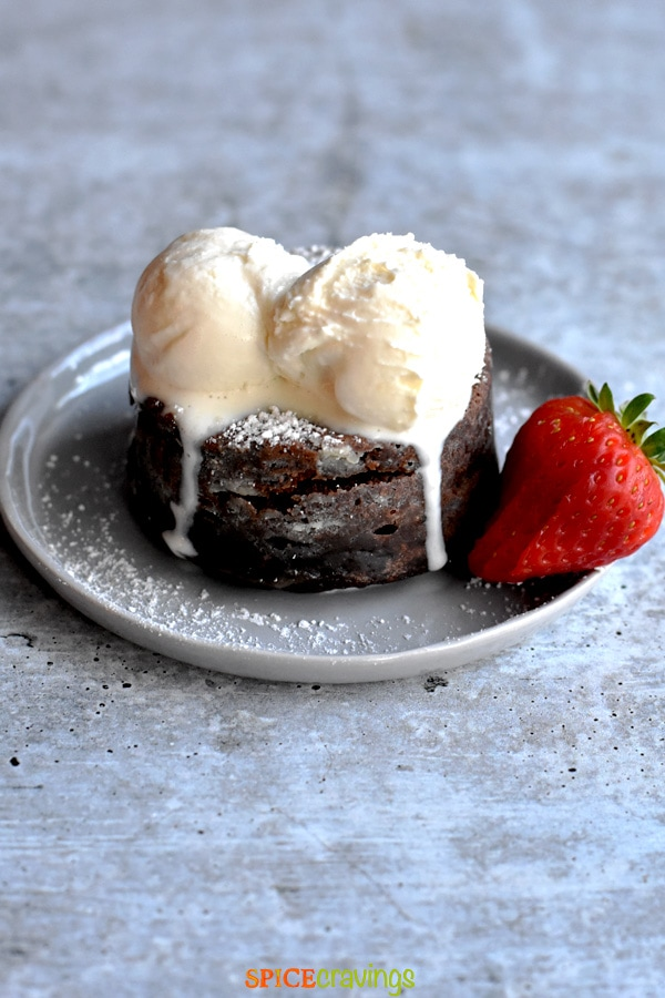 Chocolate cake topped with ice cream scoops