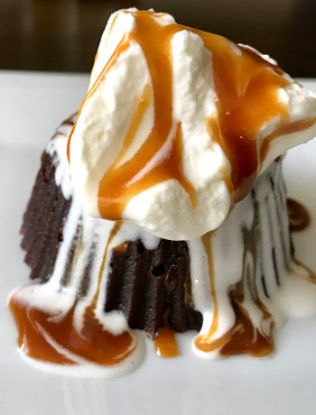 Chocolate Lava Cake served with whipped cream and caramel sauce