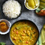 Indian Dal Fry served in a black bowl with steamed basmati rice