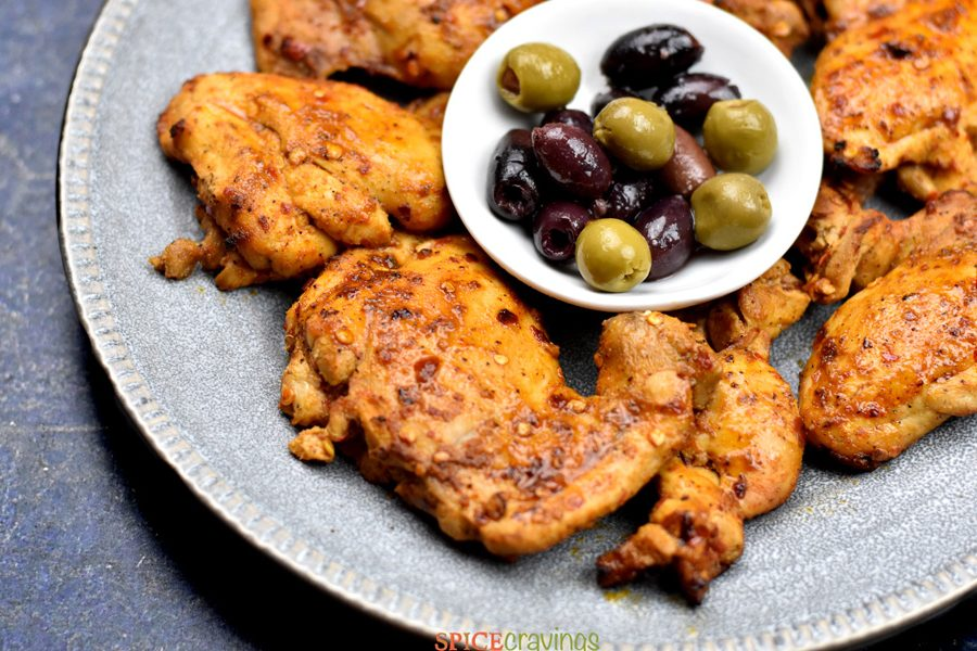 Grilled mediterranean chicken plated with mixed olives