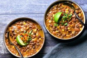 two bowls of Vegan black bean chili made in the pressure cooker