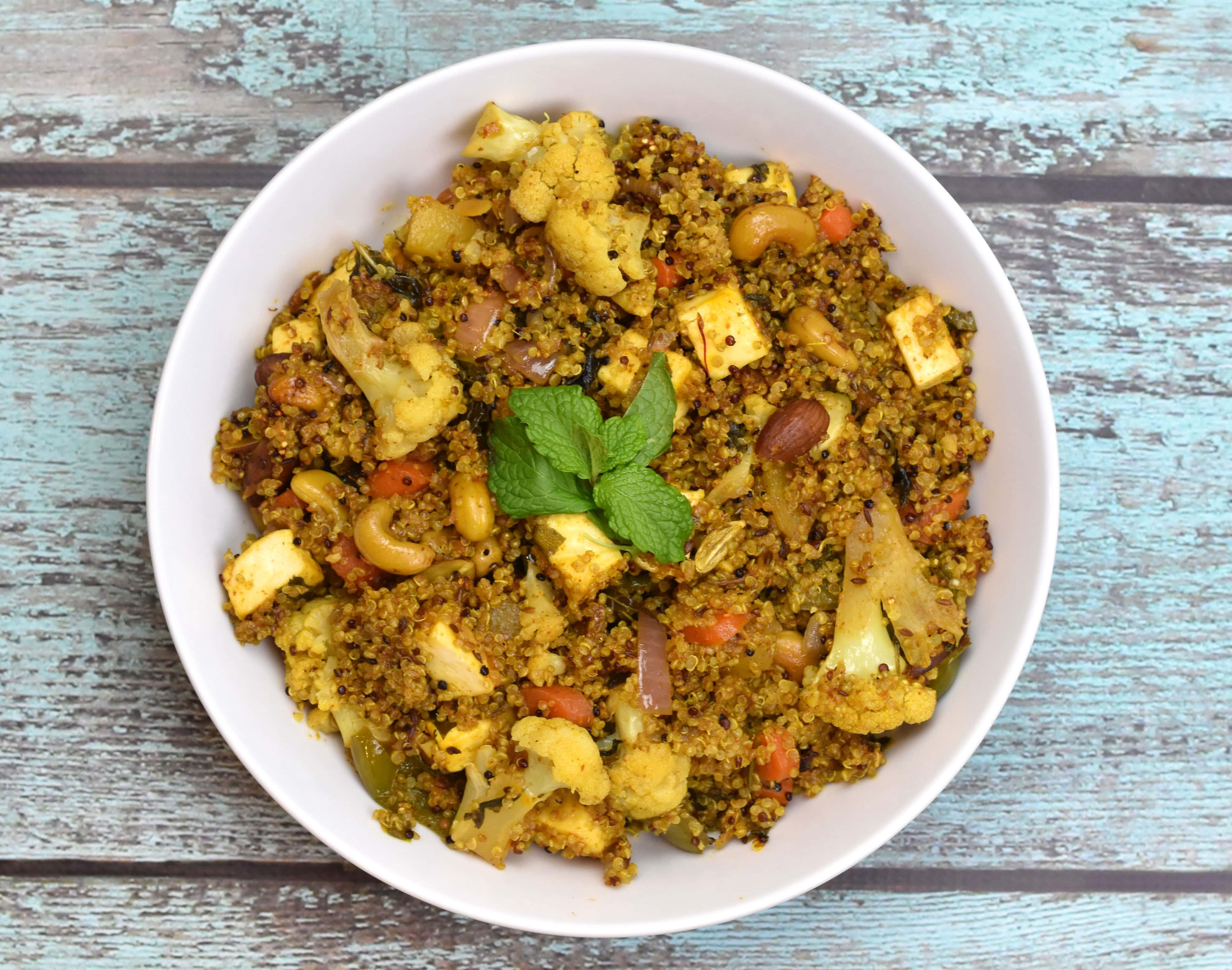 Quinoa vegetable biryani. A healthy twist to your everyday vegetarian biryani by Spice Cravings. Quinoa Vegetable Biryani/Pilaf is my healthy twist on a popular Indian classic, Vegetable Biryani! I replace rice with Quinoa in this recipe. #food #foodie #foodblogger #delicious #recipe #instantpot #recipes #easyrecipe #cuisine #30minutemeal #instagood #foodphotography #tasty #indian