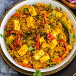 Achaari Paneer Biryani- combining two popular dishes, Achaari Paneer and Biryani in one pot by Spice Cravings. Achaari paneer biryani combines paneer cubes (Indian cottage cheese), cooked with pickling spices, with biryani, which is rice cooked with Indian spices. #food #foodie #foodblogger #delicious #recipe #instantpot #recipes #easyrecipe #cuisine #30minutemeal #instagood #foodphotography #tasty #indian