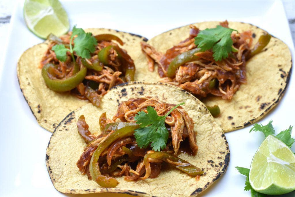 This is the QUICKEST Pulled Chicken Fajita Tacos recipe ever! Juicy and fall-apart tender chicken seasoned with Mexican chili powder, smoked paprika and earthy cumin, soaked in sweet and tangy salsa, folded in a fire grilled corn tortilla, now that's a recipe for a party in your mouth! #food #foodie #foodblogger #delicious #recipe #instantpot #recipes #easyrecipe #cuisine #30minutemeal #instagood #foodphotography #tasty
