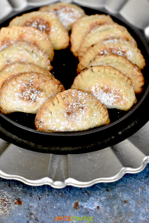 Baked turnovers on a silver charger plate