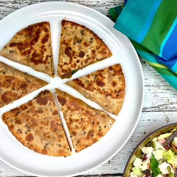 Indian spiced ground meat, keema, stuffed quesadilla served in a white plate
