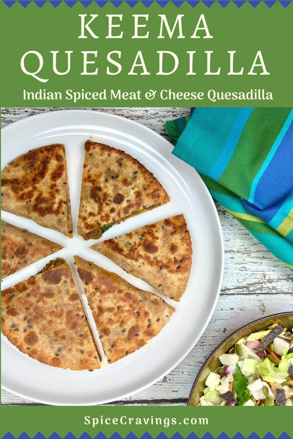 Quesadilla made with cheese and indian spiced ground meat and peas, cut in slices.