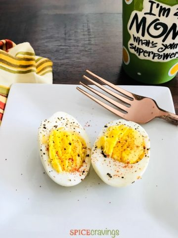 Instant Pot Hard Boiled Eggs served on a plate with a copper fork