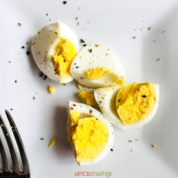 Two boiled eggs cut in half. Made using the Instant Pot hard boiled Eggs recipe