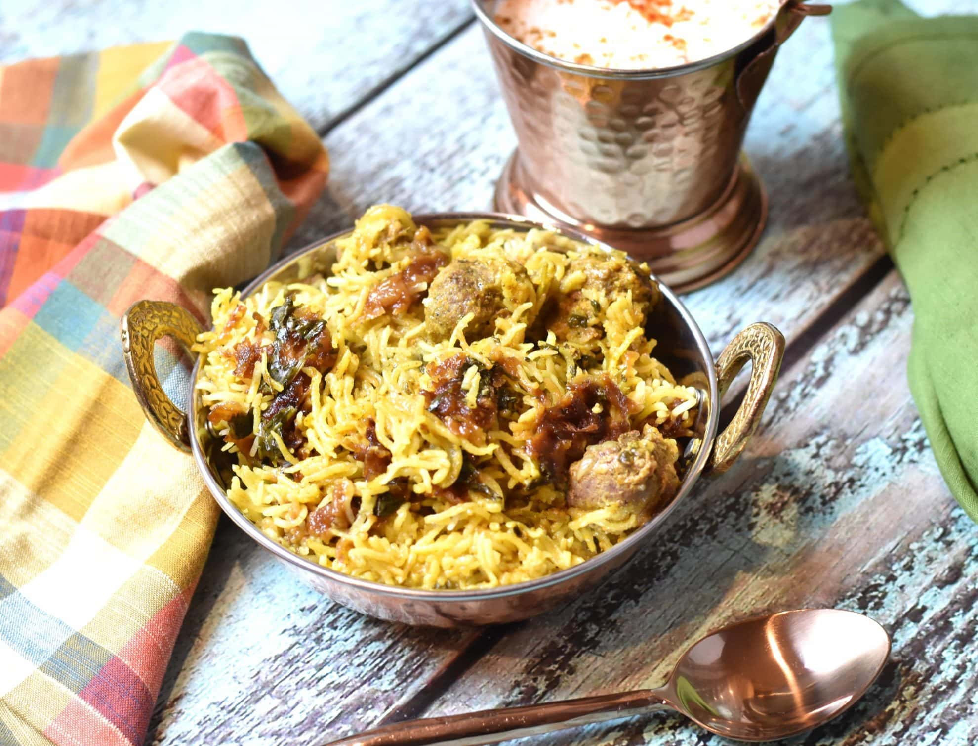 Instant pot Lamb dum Biryani / pressure cooker Lamb Biryani by Spice Cravings. Lamb Dum Biryani is a meat and rice dish where meat marinated in bold Indian spices is cooked with fragrant Basmati rice and aromatics like onions & herbs. #food #foodie #foodblogger #delicious #recipe #instantpot #recipes #easyrecipe #cuisine #30minutemeal #instagood #foodphotography #tasty #indian #curry