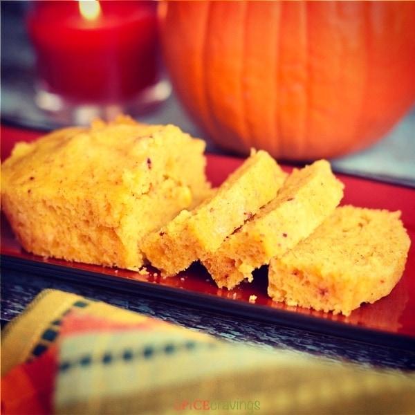 Pumpkin Spice Cornbread with a sugar pumpkin in the background