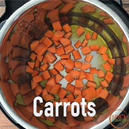 Adding chopped carrots to oil in the Instant Pot