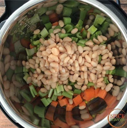 Adding northern beans to the pot