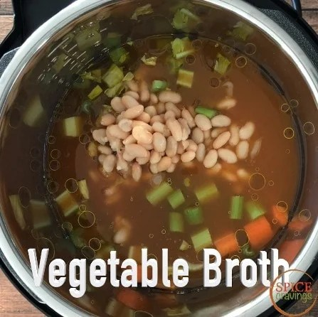 Adding vegetable broth to the pot