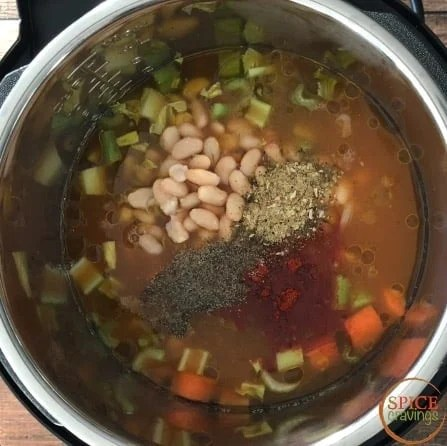Adding spices to the soup