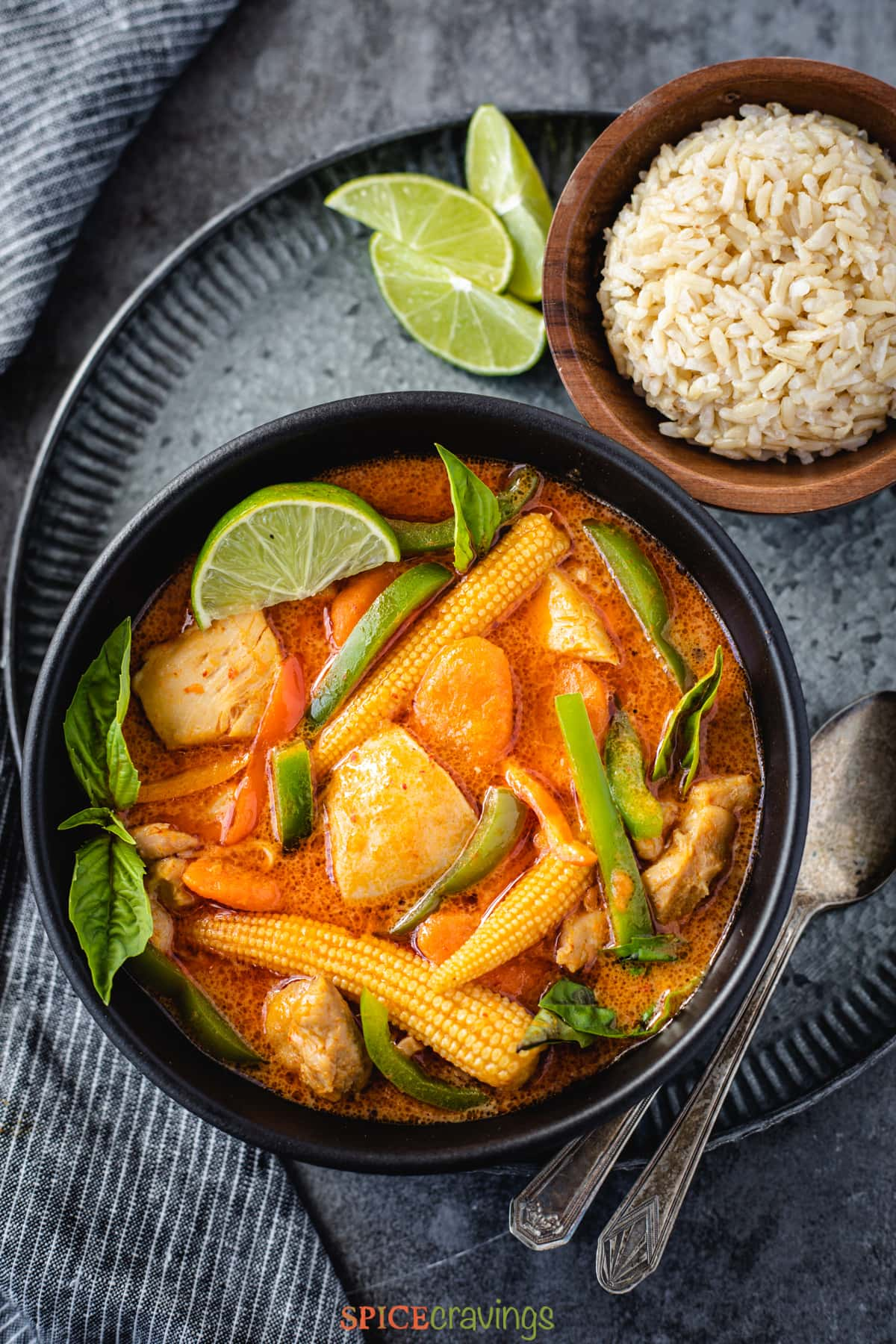 Thai panang curry served with brown jasmine rice in a grey bowl