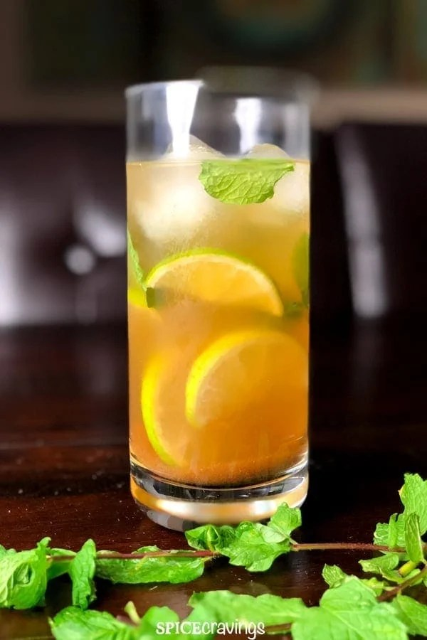 Indian spiced mojito served on ice, garnished with mint leaves