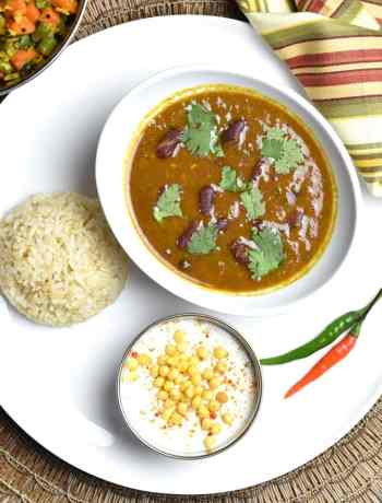 """Kidney Beans and Rice, Rajma Chawal, pot in pot, by Spice Cravings. Kidney Beans and Rice or Indian """"Rajma Chawal"""" combines Creamy beans with warm Indian spices cooked in an instant pot, served with brown rice. #food #foodie #foodblogger #delicious #recipe #instantpot #recipes #easyrecipe #cuisine #30minutemeal #instagood #foodphotography #tasty"""
