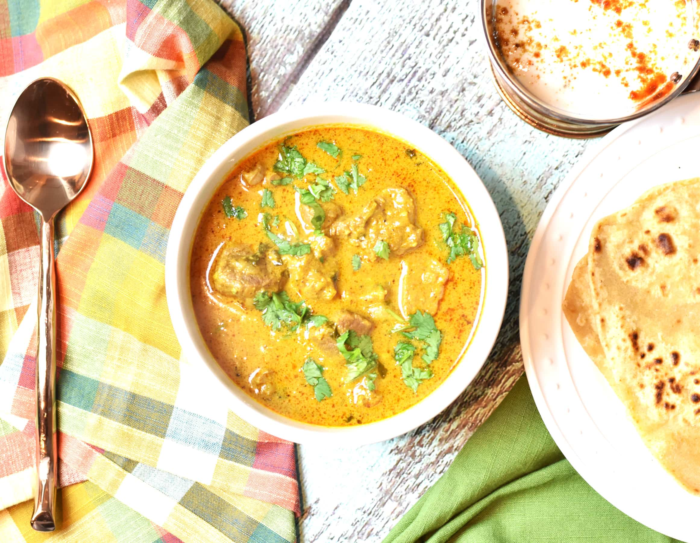 Lamb korma curry instant pot pressure cooker by Spice Cravings. Lamb Korma is an Indian Mughlai dish: Lamb stew meat is braised in a cream based sauce & bold Indian spices and simmered for hours to reach the perfection. #food #foodie #foodblogger #delicious #recipe #instantpot #recipes #easyrecipe #cuisine #30minutemeal #instagood #foodphotography #tasty #curry #indian