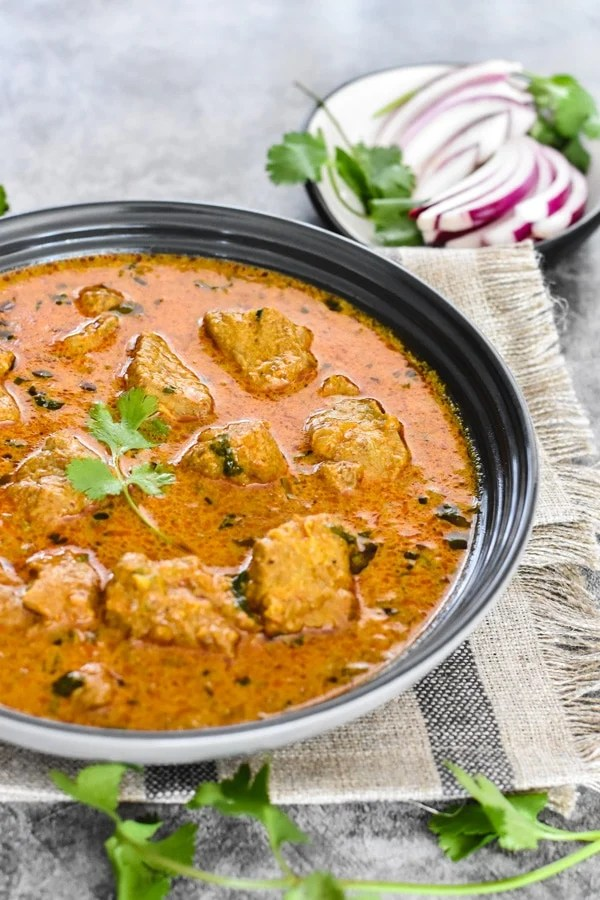 Lamb korma served in a white bowl