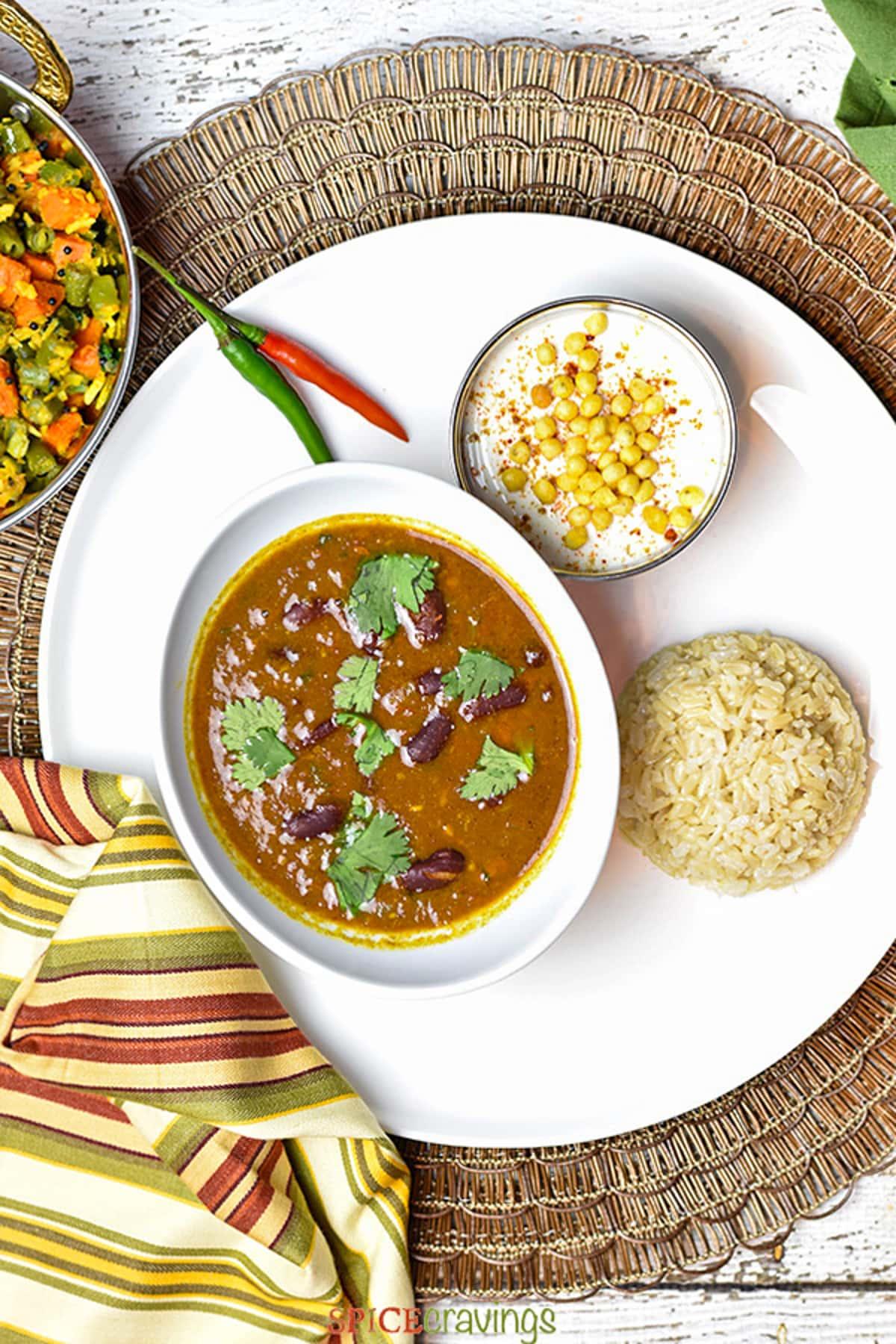 Rajma masala served with brown rice and boondi raita