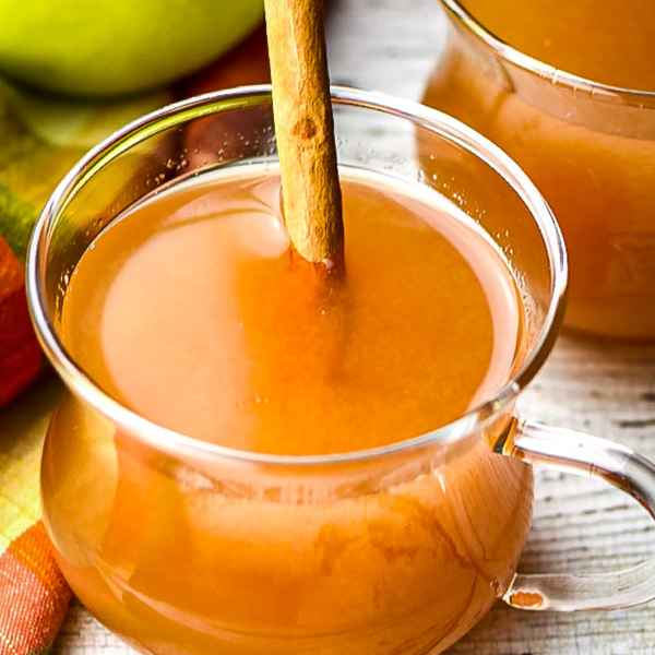 Instant Pot Spiced Apple Cider next to green and red apples