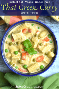 Thai green curry with peas, baby corn and tofu served in a blue bowl