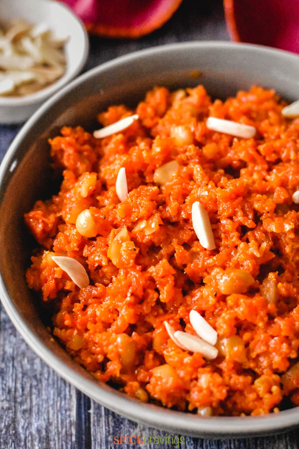 Grated carrots cooked with milk to make Carrot Halwa, served with slivered almonds